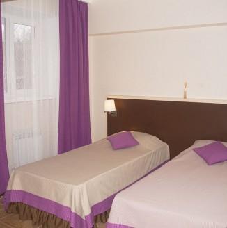 Фиолетовая комната А-БУТИК ОТЕЛЬ