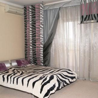 Оформление шторами спальни в стиле модерн